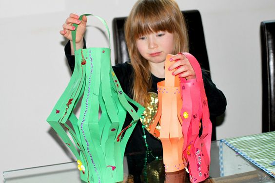 Celebrate the Chinese New Year by making these festive paper lanterns with your child!