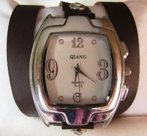 Unisex wrap watch with a vintage look . Handcrafted leather strap wraps around your wrist.  This unique Handmade Watch is made with a real, high quality dark brown leather band.