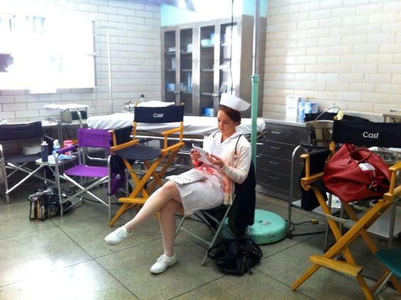 """""""On the set of """"Parkland"""" Nurse studying her lines for ER scene as JFK arrives to Parkland hospital. #jfkassasination"""""""