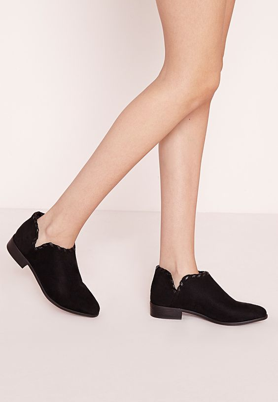 Strutting your stuff in style has never been so easy and with these totally on point flats, you have heads turning where-ever! In a faux suede finish, woven detailing to the trim and in on trend black these ankle boots are perfect for that ...