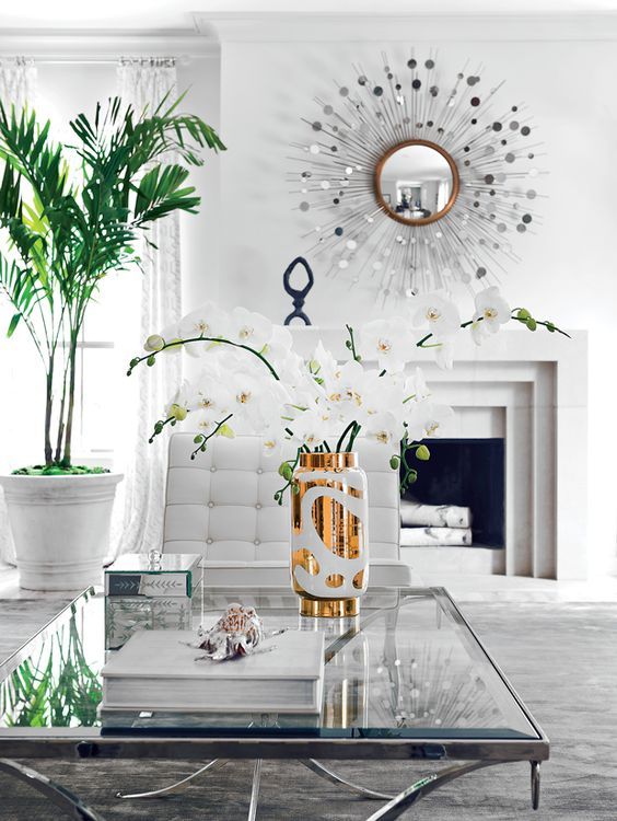 White Living Room Vignette. love the gold and the palm with the white.