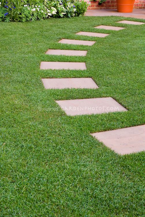 Stepping Stone For Garden Stepping stones in perfect lawn grass leading in an arc to backyard stepping stones in perfect lawn grass leading in an arc to backyard patio with perennial plants and flowers at rear pool pinterest backyard patio workwithnaturefo