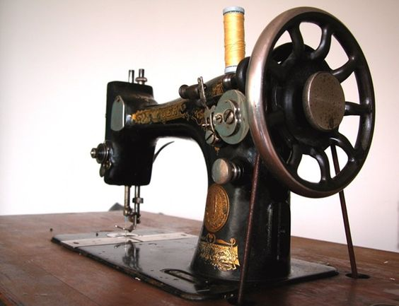 Google Image Result for http://lighterportions.files.wordpress.com/2010/05/old_sewing_machine.jpg