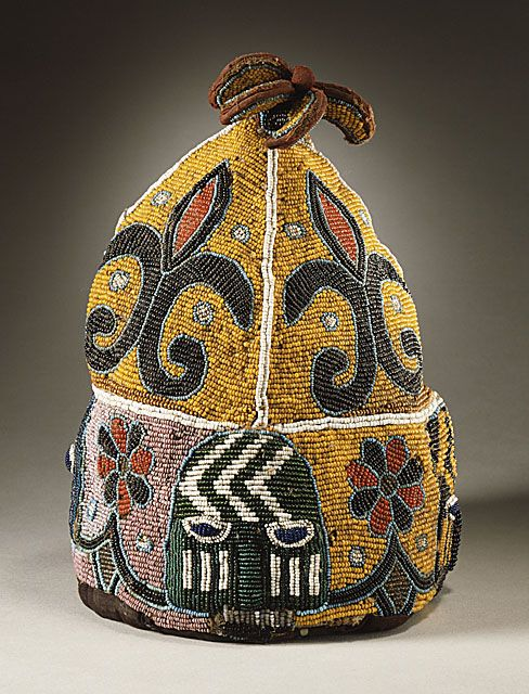 Africa |  Oba's beaded royal crown.  Nigeria, Yoruba peoples.  20th century | Materials:  glass beads embroidered on plain weave striped and painted cotton over a metal frame.  Ritual/ceremonial object