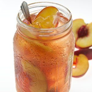 Peach Tea -6 large sweet peaches -4c water -1c sugar -4c tea ~Boil sliced peaches w/ skin in pan w/ 4c of water & 1c of sugar on med. Reduce to simmer & cook for 1hr. Turn off & cool for 1hr. Set a sieve over a collecting container, place a thin tea towel or cheese cloth over the sieve. (Sometimes in a pinch a coffee filter will work) Sieve fruit. Shold be about 4c of syrup. For Tea place a quart of brewed tea in a pitcher & stir in 1 1/2c of the 'cold' syrup. Will not be sweet may add…