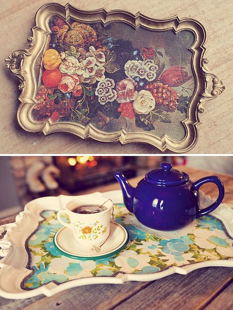 buy old trays from thrift store, and mod-podge bottom (: