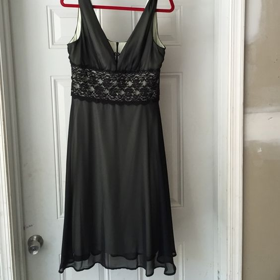 Ladies sz 14 dress Sz 14 evening apparel ladies dress black with a tinted green lining, has a small snag shown I photo , you can hardly see, dress is beautiful. Dresses