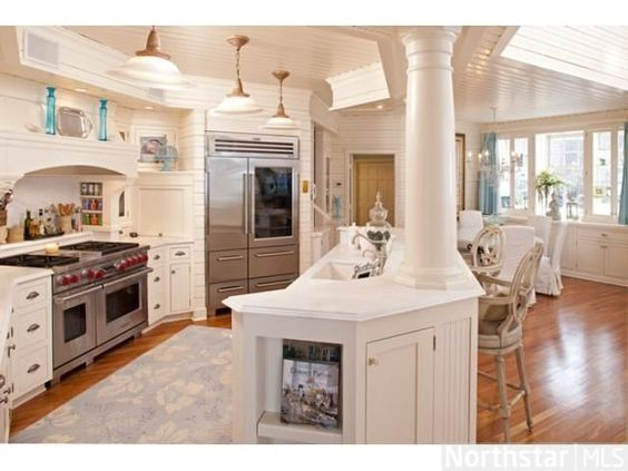 Love everything from the ceiling to the chef's stove and fridge in this Greenwood MN home