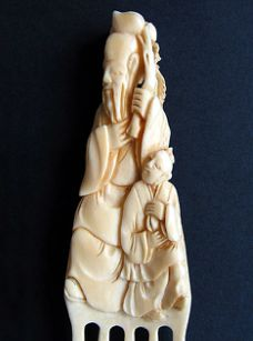 Chinese ivory comb carving of Shou Xing, God of Longevity. From the collection of Jen Cruse.