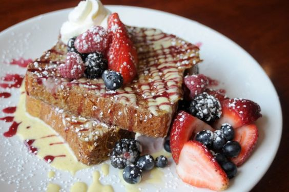 Decadent french toast and fruit from Wildberry Pancakes and Cafe in the #Loop serves as a delicious addition to any late-morning brunch.