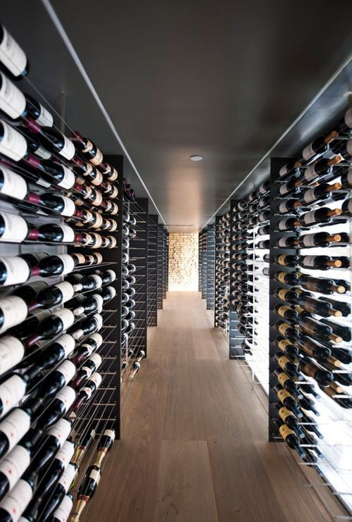WIC til meg, WIWC til Bjørn :) Ultra modern walk-in wine cellar. Grab a bottle and take the night off!