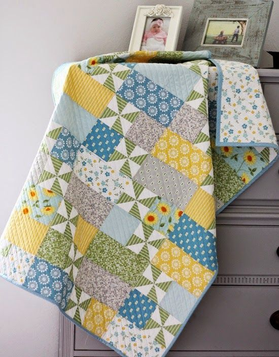 Simple pattern, straight line quilted on the diagonal in the direction of the pinwheels. In love. Lovely colours.