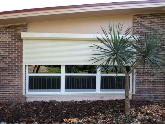 Shutters Screens Awnings For Hurricane Security Shade Deck And Patio Sarasoata Bahama Shutters Shutters Hurricane Shutters