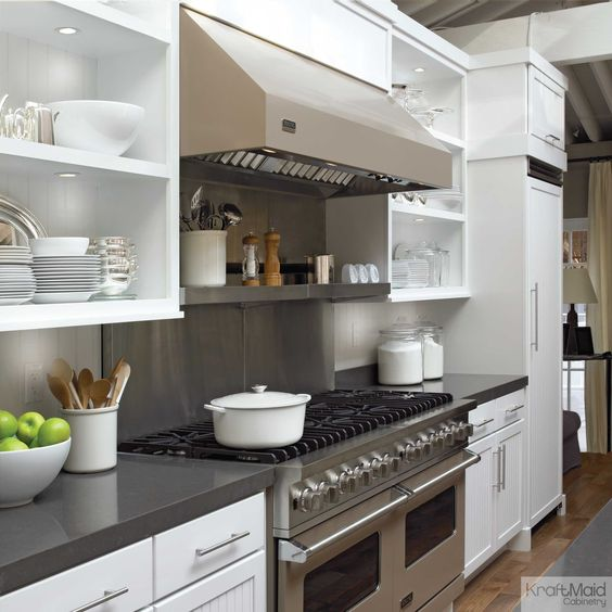 Dove white cabinetry and open shelves keep this kitchen for Kraftmaid coreguard