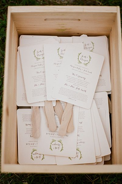 Dual-purpose guest programs are the way to go — that piece of paper gets more of your money's worth if it serves another function! These programs feature popsicle stick handles, perfect for guests to use as a fan when it gets too hot at an outdoor ceremony.Related:15  Creative Wedding Program Ideas
