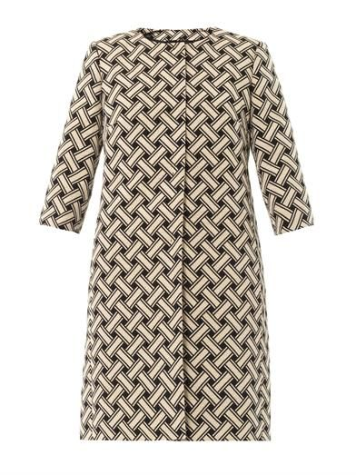 This black and cream basket-weave jacquard coat is collarless, has a round-neck and 3/4 length sleeves. The straight-cut slim fitting coat has side pockets and a concealed button centre-front fastening.