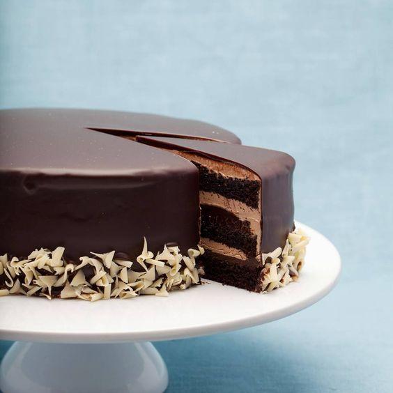 Triple-chocolate cake. Chocolate Devil's food cake, smooth chocolate buttercream and dark chocolate truffle layered together and glazed in chocolate.