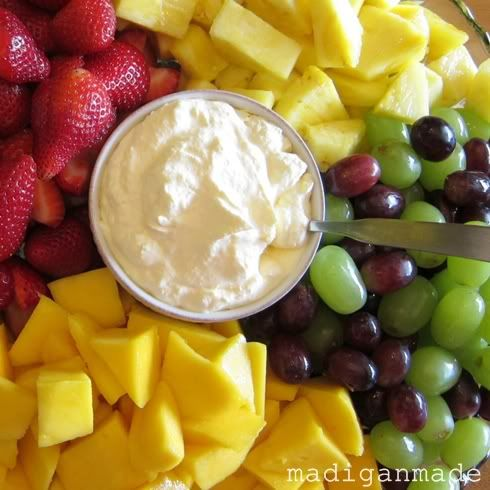 Orange Creamsicle Summer Fruit Dip - 1 8 oz container whipped topping,  1 small package instant vanilla pudding mix,  1 6 oz container of frozen (concentrated) orange juice,  Fruit for dipping (strawberries, mango, grapes, pineapple, etc)
