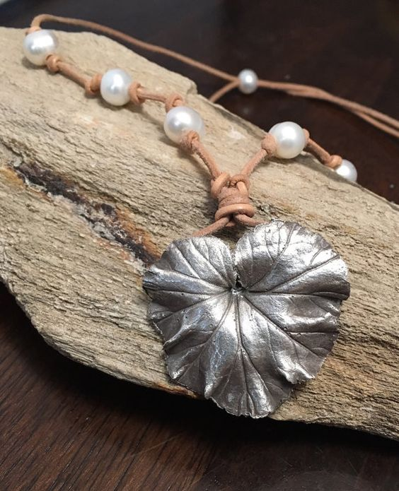 This unique nature inspired necklace was created using precious metal clay slip. It was hand painted onto a real geranium leaf with 12