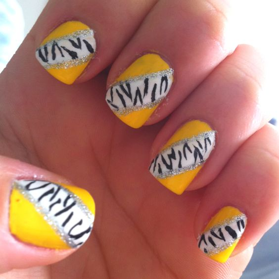 I also got this idea from cute polish on YouTube! Yellow with zebra pattern nail design! Yellow nail polish black,white, and silver nail striper. It was also easy for me to do yellow toe nails and the design on my big toe :)