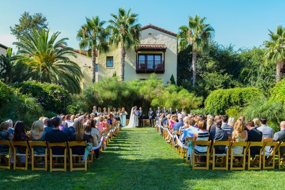 Outdoor ceremony. LVL Weddings & Events // Photography: Nathan Jaffan Photography// Floral: Bloomers La Jolla // Venue: Estancia La Jolla Hotel & Spa // DJ / Ceremony Musician:  Kevin Miso // Cake: Sweet Lydia's of San Diego // Photo Booth: Shutterbooth // Dress: Katie May // Shoes: Badgley Mischka