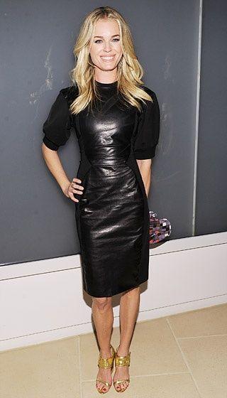 Rebecca Romijn wearing a black faux-leather dress with puff-cap ...