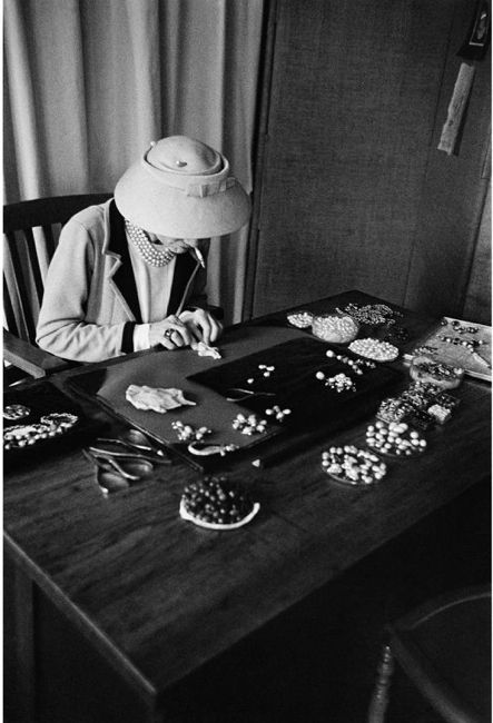 Coco Chanel designing her jewelry.