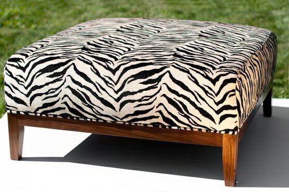 #Custommade ottoman.   Zebra upholstery with a solid walnut base.