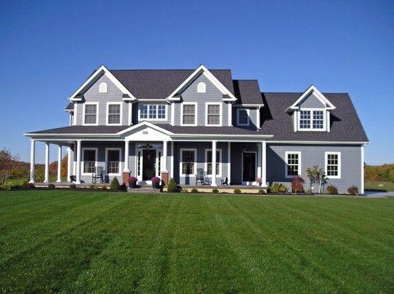 Gray exterior farmhouse wraparound porch abode love for Farmhouse exterior