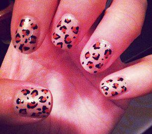 Leopard Print Nails - Start with nude polish base, use Terracotta color polish to place center spots, use black nail art polish to finish. #nailart