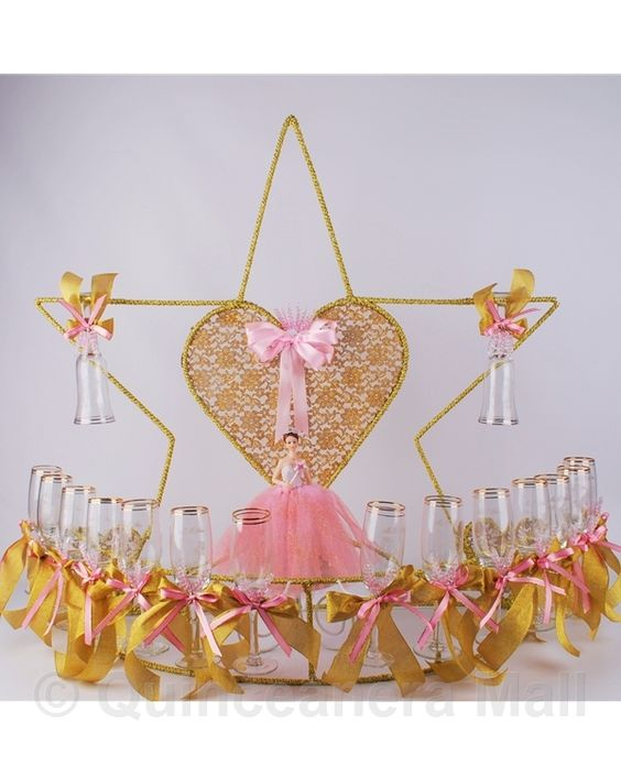"Star Toasting Set #TS23 34"" Star with Heart toasting set is decorated with your choice colors. ""Mis 15 Anos"" and a pretty quinceanera figurine design are edged on every glass."