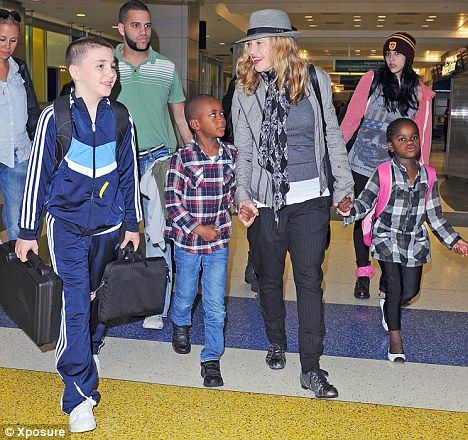 Madonna with the rest of her brood, Lourdes, Rocco, David and Mercy.