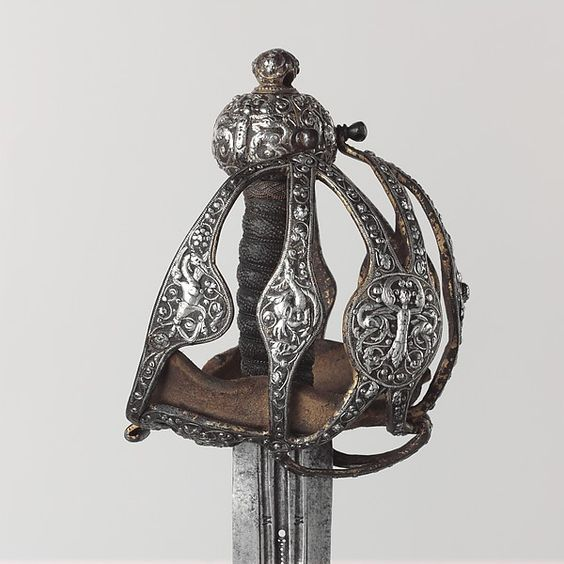 Basket-Hilted Sword Date: 1600–1625 Culture: British Medium: Steel, silver Dimensions: L. 39 3/8 in. (100 cm); L. of blade 33 in. (83.8 cm); greatest W. 5 3/4 in. (14.6 cm); greatest W. of blade 1 11/16 in. (4.3 cm); greatest D. of blade, 3/16 in. (0.5 cm); Wt. 3 lb. 13 oz. (1729 g)