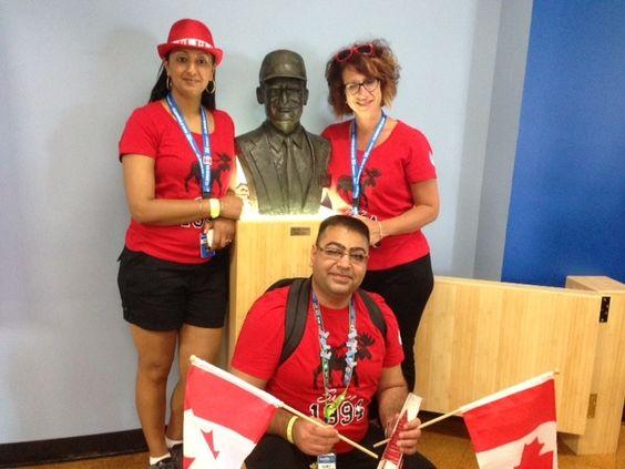 Paula Brar & Lori Ann Ramano ( Both Dist Mgrs) / Sumit with Sam Walton statue at WM US Home Office [2014]