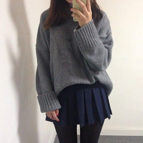 Monochrome winter look with the large oversized grey sweater, AA navy pleated skirt, and black tights