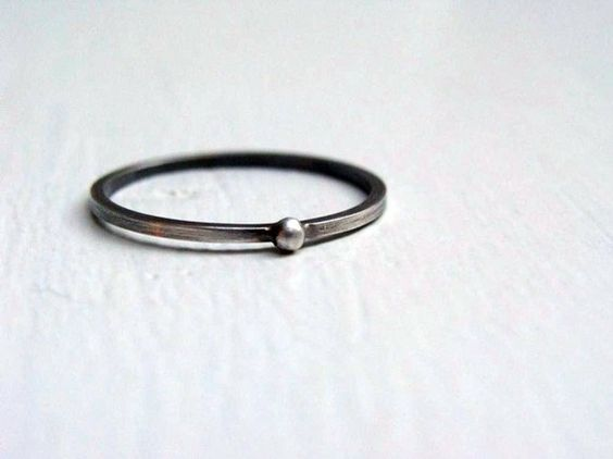 Simple, more than simple, the most simple.  Made in sterling silver. Has an oxidized and rustic finish.