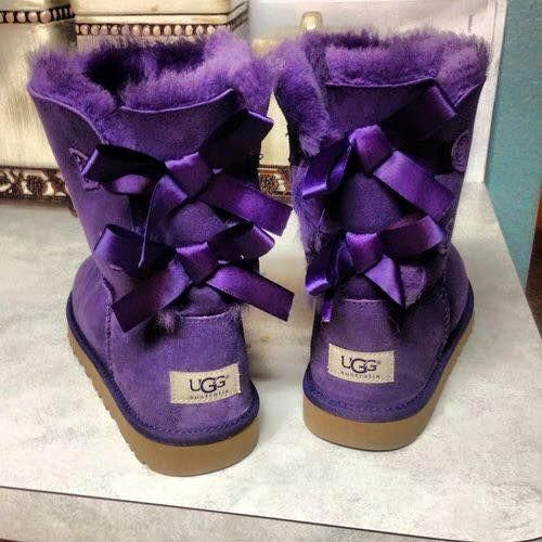 Pair of purple ugg boots snow boots