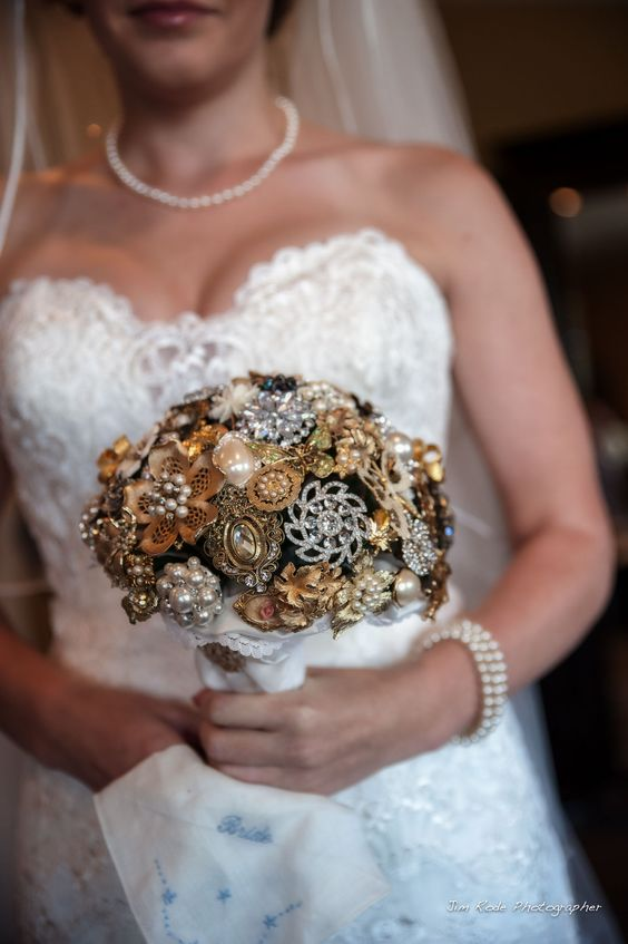 A broach bouquet with borrowed, blue, grandparents and everything meaningful to carry down the aisle.