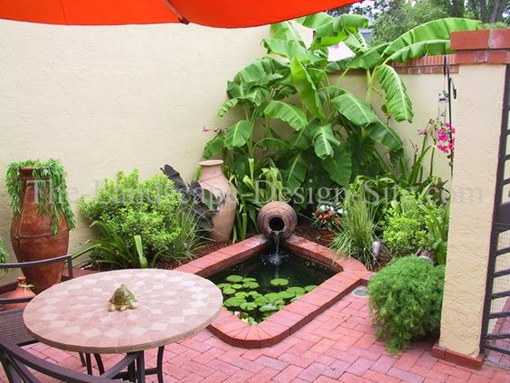 Small courtyard patio with pond and fountain from s s for Design criteria of pond