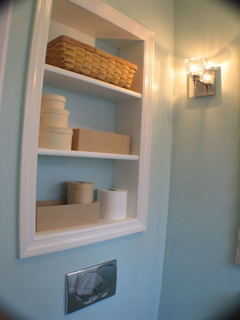 Was thinking of a medicine cabinet in the small powder room...but loving the way this looks!! Hmmmm???
