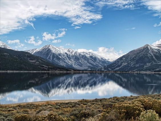 Pictured:  Twin Lakes, Colorado    Here is a list of the top 10 lakes to visit in the summer.  From Maine to California, these stunning lakes offer breathtaking retreats.