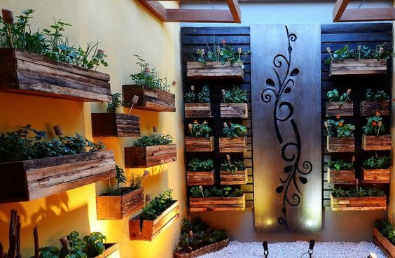 Recycling !!cachepots this vertical garden are made with scrap wood taken from the trash. Bottle stoppers were used in place of plaque common to identify what is planted