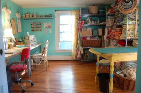 Sewing room inspiration -- I love the dresses hanging on the walls