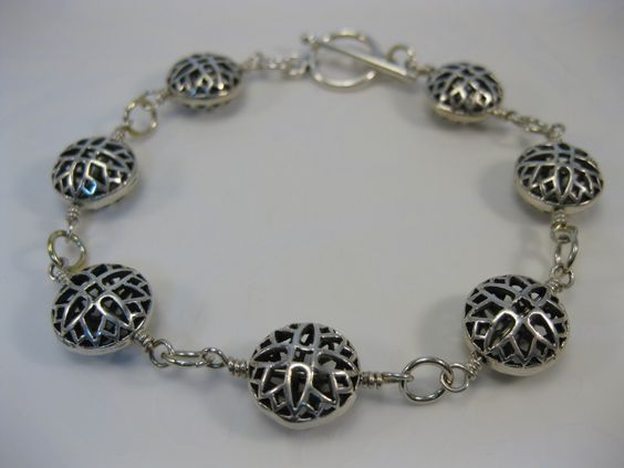 Bali sterling silver filigree cross design coin shaped beads wire wrapped Everyday sterling silver  bracelet - pinned by pin4etsy.com