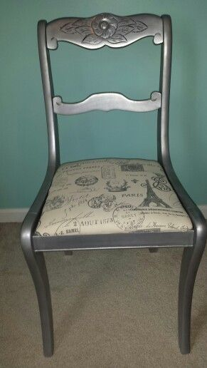 """After picture of """"trash"""" chair - painted silver with black glaze and French themed fabric."""