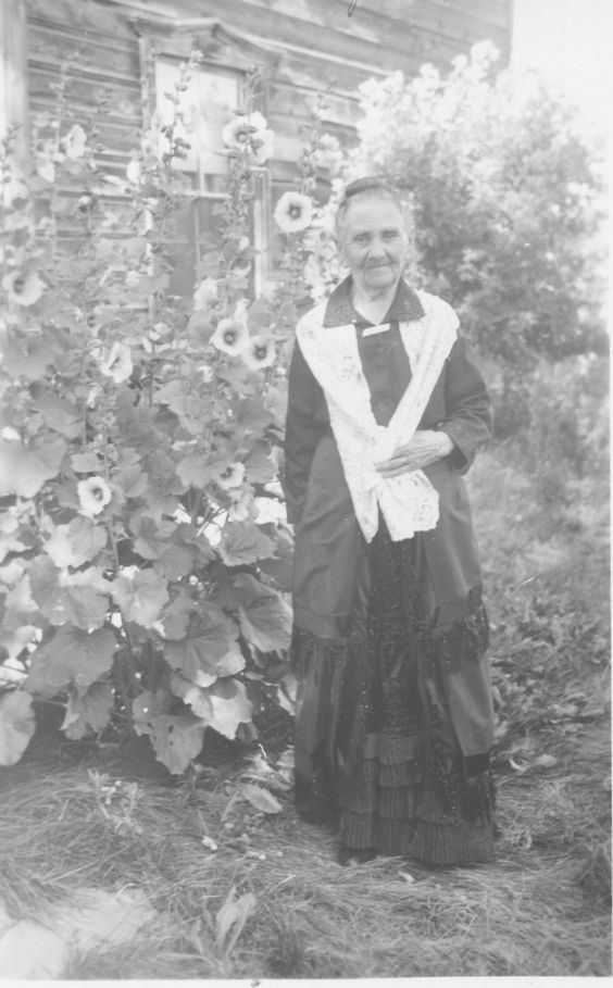 Matilda Robey...I discovered this old photo while working on my genealogy. I've always loved hollyhocks, and have them in my garden. When I looked at those stately hollyhocks in the background, I wondered if she loved them as well...a trait handed down through the generations of my family tree.:
