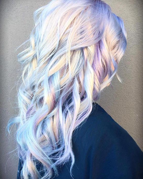 """This gorgeous iridescent, opal blonde by @rossmichaelssalon is everything! Create subtle pastel tones by adding small increments of direct dye to Olaplex #2 which will not only add a hint of color but will also fortify and strengthen prelightened..."