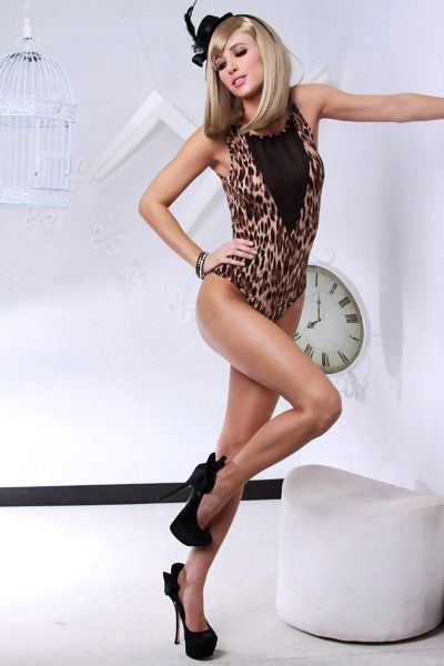 This is a very sexy outfit featuring leopard print, leotard style, mesh details, and finished with scoop neckline.  Polyester/Spandex.  0222