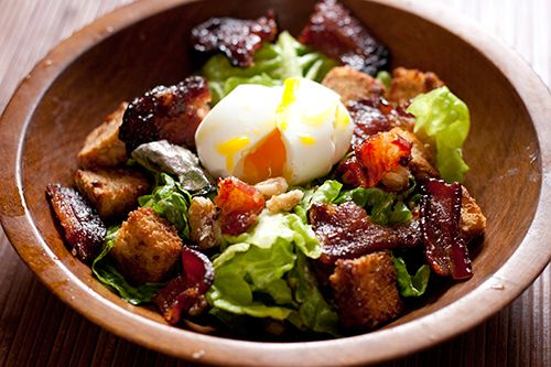 Breakfast salad with soft boiled egg.