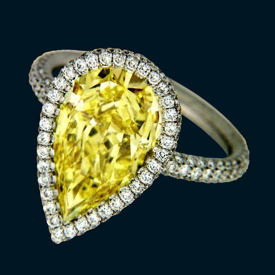 Diamonds 4.54-carat fancy vivid yellow diamond ring in platinum with 1.23 carats of melee by Rahaminov